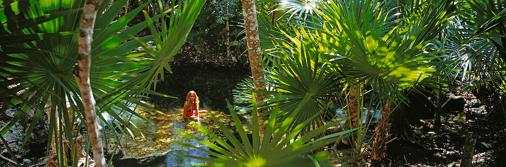MEXICO, TOURISM, YUCATAN PN. Cenote Azul near Playa del Carmen; one of the most beautiful cenotes surrounded by palms and mangroves