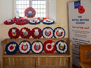 Village parish church Shotley, Suffolk, England, UK Royal British Legion remembrance poppy wreaths