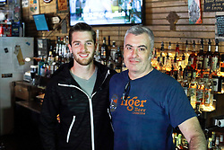 23 November 2015. Finn McCool's Irish Pub, New Orleans, Louisiana.<br /> Major League Soccer (MLS) star player Patrick Mullins of New York City FC poses for a photo with Steve Patterson, (r) owner of Finn McCool's.<br /> Photo©; Charlie Varley/varleypix.com
