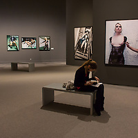 A girl reads a book at the exhibition of american fashion photographer Helmut Newton in Budapest, Hungary on April 02, 2013. ATTILA VOLGYI