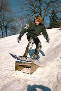 16 yr old jumping with snowboard.   St Paul Minnesota USA