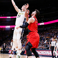 09 April 2018: Denver Nuggets center Mason Plumlee (24) goes for the baby hook over Portland Trail Blazers center Jusuf Nurkic (27) during the Denver Nuggets 88-82 victory over the Portland Trail Blazers, at the Pepsi Center, Denver, Colorado, USA.