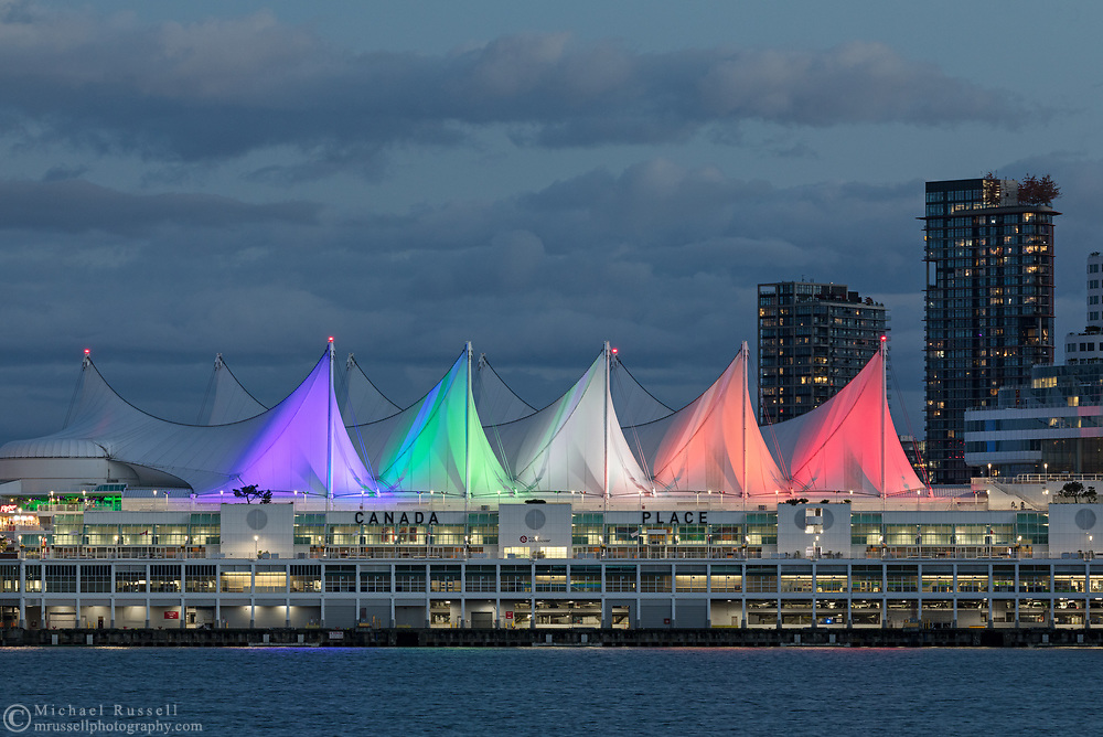Colored lights decorate the sails on Canada Place in Vancouver, British Columbia, Canada. Located on the edge of Coal Harbour, Canada Place serves as a cruise ship terminal, trade and convention center space, and was the Canada Pavilion during Expo 86.