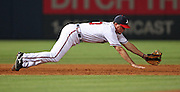 ATLANTA - JUNE 25:  Third baseman Chipper Jones #10 of the Atlanta Braves makes a diving catch on a groundball during the game against the New York Yankees at Turner Field on June 25, 2009 in Atlanta, Georgia.  The Braves lost to the Yankees 11-7.  (Photo by Mike Zarrilli/Getty Images)