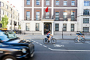 """Cyclists drive by the Chinese Embassy in London on Monday, July 20, 2020 - as the U.K., tensions with China are rising. United Kingdom suspended the extradition treaty with Hong Kong """"immediately and indefinitely"""" as well as existing embargo arms against China is extended to Hong Kong U.K. Foreign Secretary Dominic Raab announced on Monday afternoon through a statement in the British Parliament.<br /> (VXP Photo/ Vudi XHymshiti)"""