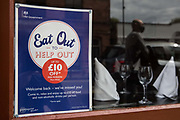 An Eat Out To Help Out poster is pictured in a restaurant window on the final day of the government's subsidised meal scheme on 31 August 2020 in Windsor, United Kingdom. Many restaurant owners have called for an extension to the scheme introduced by the Chancellor of the Exchequer to help preserve hospitality jobs during the COVID-19 pandemic.