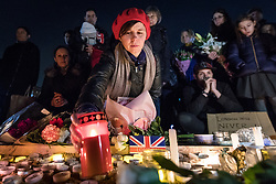 © Licensed to London News Pictures. 23/03/2017. London, UK. People light candles in remembrance as thousands join a vigil in Trafalgar Square for the victims of the Westminster terrorist attack, which took place on 22 March 2017. Photo credit: Rob Pinney/LNP