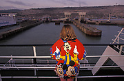 A young passenger wearing a jumper adorned with Disney characters looks across to the Port of Dover as she arrives on a cross-Channel ferry from France, on 18th June 1990, in Dover, England.