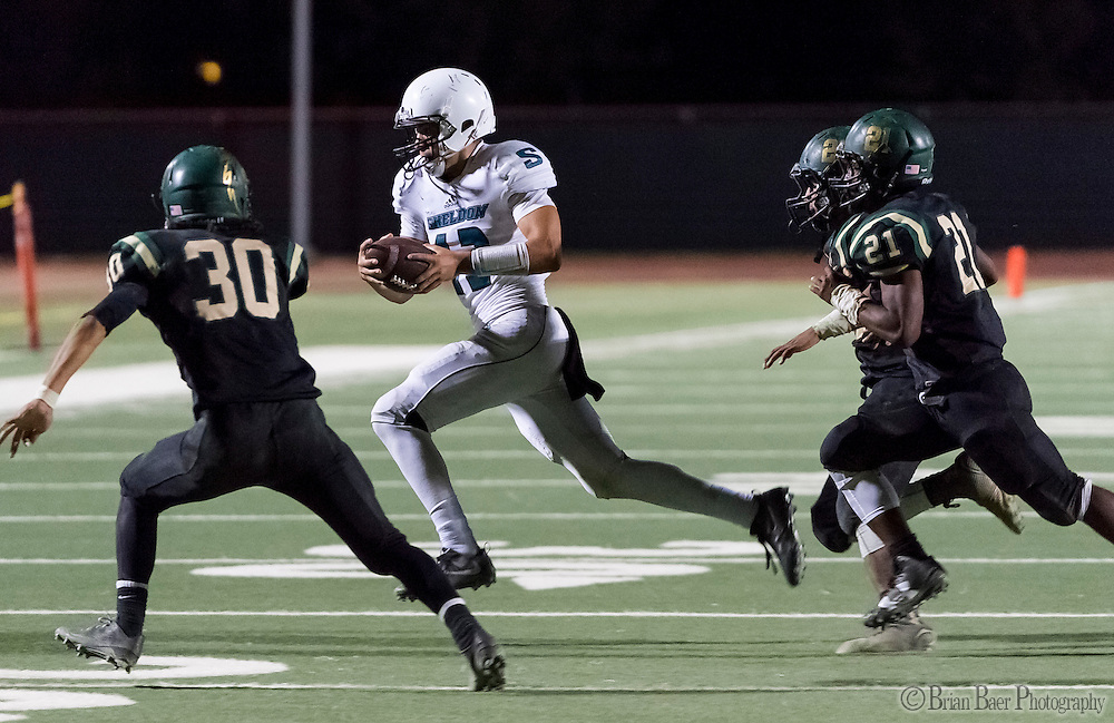 Sheldon High School Husky Chancellor Lachapelle (12), runs with the ball during the third quarter as the Monterey Trail Mustangs host the Sheldon High School Huskies Friday Sep 23, 2016. Sheldon won the game 27-22.<br /> photo by Brian Baer