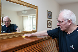 Pensioner in supported housing cleaning