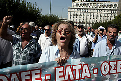 October 3, 2016 - Athens, Greece - Pensioners shout slogans against the government, marching outside the Parliament in Athens, on Monday October 3, 2016. Greek pensioners taking part at a protest march against pension cuts, demanted meeting with Prime minister but were stoped with tear gas by riot police close to the government's headquarters. (Credit Image: © Panayiotis Tzamaros/NurPhoto via ZUMA Press)