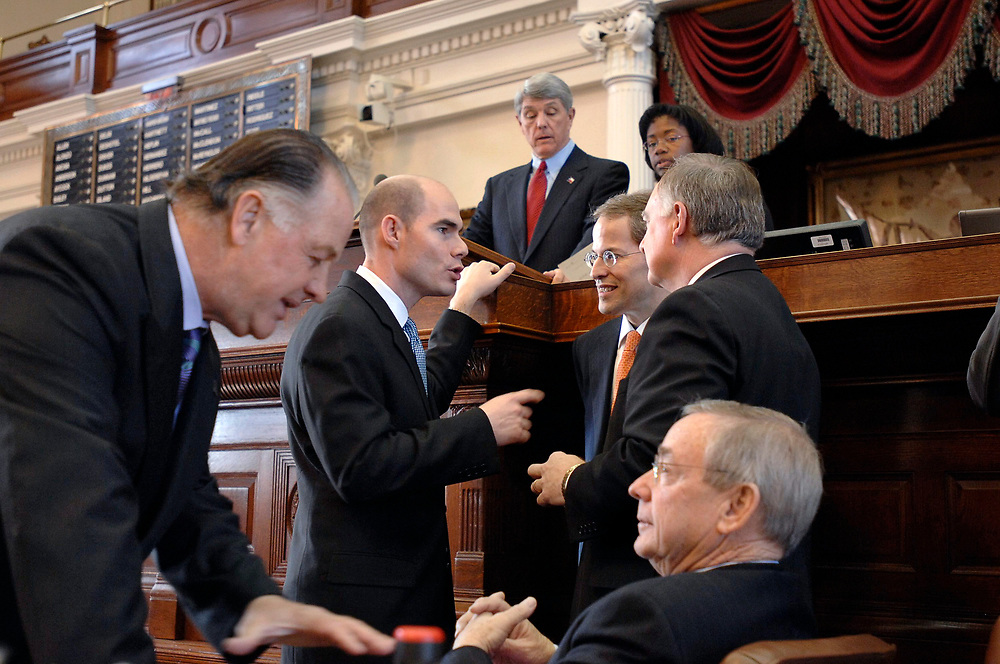 Austin, Texas: January 10, 2007: Opening day of the 80th session of the Texas Legislature in the House of Representatives, showing   showing House members confering on introducing new bills on the first day of the session. At far left is Rep. Tommy Merritt, at far right is Rep. Warren Chisum.   ©Bob Daemmrich/