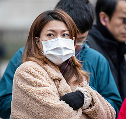 © Licensed to London News Pictures. 31/01/2020. London, UK. A young women wears a protective masks as she walks along Westminster Bridge this morning as two patients are confirmed to have the Coronavirus in the UK. Photo credit: Alex Lentati/LNP