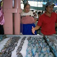Oceania, French Polynesia, Tahiti. Fish vendor at Papeete Market.