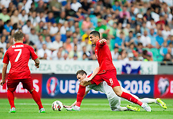 Milivoje Novakovic of Slovenia vs Chris Smalling of England during the EURO 2016 Qualifier Group E match between Slovenia and England at SRC Stozice on June 14, 2015 in Ljubljana, Slovenia. Photo by Vid Ponikvar / Sportida