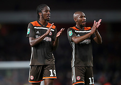 Brentford's Romaine Sawyers (left) and Kamohelo Mokotjo applaud the fans after the final whistle of the Carabao Cup, Third Round match at the Emirates Stadium, London.