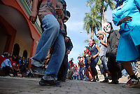 """MEXICO, Veracruz, Tantoyuca, Oct 27- Nov 4, 2009. Partially masked dancers rehearse in Tantoyuca's """"Plaza Constitucion."""" """"Xantolo,"""" the Nahuatl word for """"Santos,"""" or holy, marks a week-long period during which the whole Huasteca region of northern Veracruz state prepares for """"Dia de los Muertos,"""" the Day of the Dead. For children on the nights of October 31st and adults on November 1st, there is costumed dancing in the streets, and a carnival atmosphere, while Mexican families also honor the yearly return of the souls of their relatives at home and in the graveyards, with flower-bedecked altars and the foods their loved ones preferred in life. Photographs for HOY by Jay Dunn."""