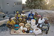The Natomo family on the roof of their mud-brick home in Kouakourou, Mali, with a week's worth of food. From the book Hungry Planet: What the World Eats (Model Released)