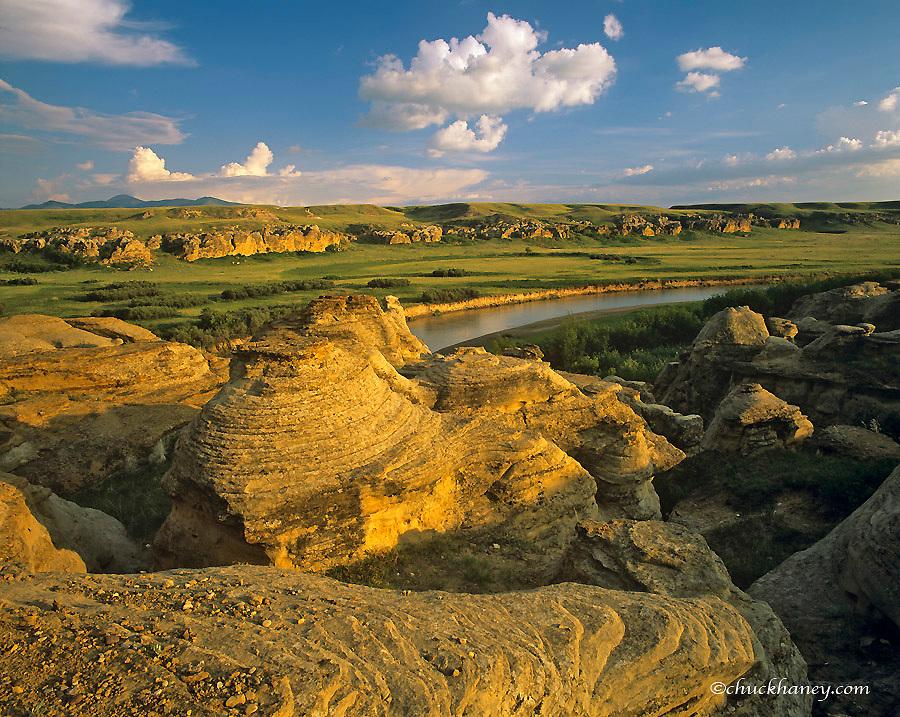The Milk River runs through badlands of Writing on Stone Provincial Partk in Alberta Canada