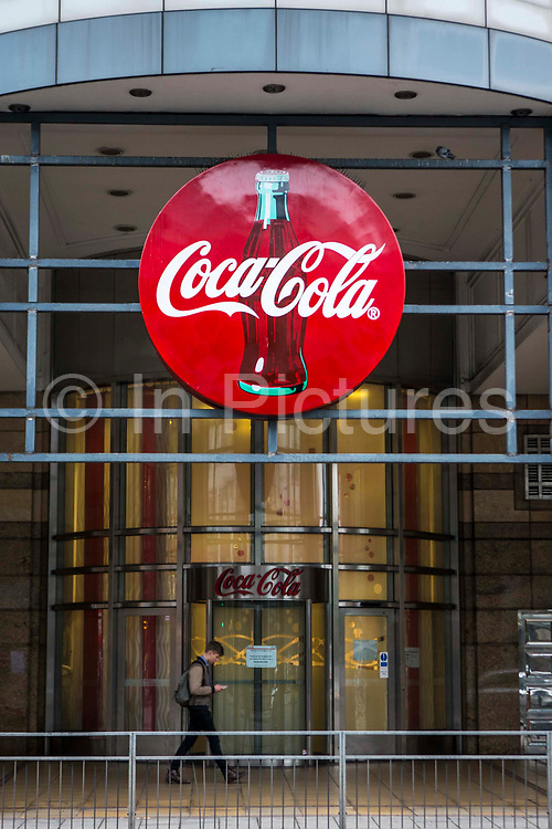 The famous red sign outside Coca Cola headquarters, Hammersmith, London, United Kingdom.