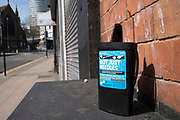 Needle disposal box in Digbeth in the city centre, which is virtually deserted under lockdown on 15th April 2020 in Birmingham, England, United Kingdom. Coronavirus or Covid-19 is a new respiratory illness that has not previously been seen in humans. While much or Europe has been placed into lockdown, the UK government has put in place more stringent rules as part of their long term strategy, and in particular social distancing.