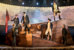 "© Licensed to London News Pictures. 10/10/2018. LONDON, UK.  Actors perform during a preview, ahead of the European premiere of ""The Wider Earth"" at the Natural History Museum.  Actor Bradley Foster plays the young 22 year old Darwin setting out on his five year voyage on HMS Beagle.  The cast features War Horse actors, as well as 30 puppets representing the tropical wildlife Charles Darwin encountered on his voyage.  The show is hosted in the new 357-seat theatre in the Jerwood Gallery and runs until 30 December 2018.  Photo credit: Stephen Chung/LNP"