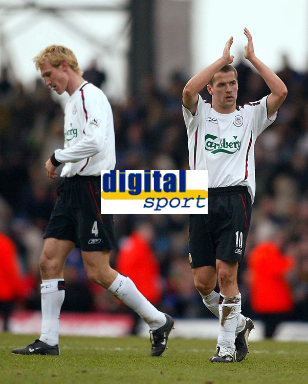 Photo: Scott Heavey.<br /> Portsmouth v Liverpool. FA Cup 5th Round replay. 22/02/2004.<br /> Sami Hyypia and Michael Owen trudge off after the 1-0 defeat