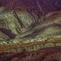 The sun spotlights a village near Muktinath, Nepal, north of Annapurna.