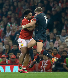 Sione Vailanu of Tonga hands off Dan Biggar of Wales<br /> <br /> Photographer Simon King/Replay Images<br /> <br /> Under Armour Series - Wales v Tonga - Saturday 17th November 2018 - Principality Stadium - Cardiff<br /> <br /> World Copyright © Replay Images . All rights reserved. info@replayimages.co.uk - http://replayimages.co.uk