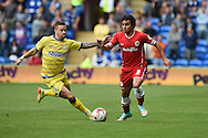 Fabio Da Silva of Cardiff city ® goes past Chris Maguire of Sheff Wed (l). Skybet football league championship match, Cardiff city v Sheffield Wed at the Cardiff city stadium in Cardiff, South Wales on Saturday 27th Sept 2014<br /> pic by Andrew Orchard, Andrew Orchard sports photography.