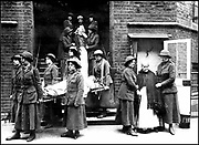 World War I - 1914-1918: Members of the British Women's Volunteer Reserve carrying out a practice fire drill and evacuating elderly patients from a hospital.