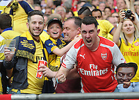 Arsenal fans celebrates after Arsenal's Theo Walcott (not in frame )scores the opening goal <br /> <br /> Photographer Ashley Crowden/CameraSport<br /> <br /> Football - The FA Cup Final - Aston Villa v Arsenal - Saturday 30th May 2015 - Wembley - London<br /> <br /> © CameraSport - 43 Linden Ave. Countesthorpe. Leicester. England. LE8 5PG - Tel: +44 (0) 116 277 4147 - admin@camerasport.com - www.camerasport.com