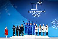 PYEONGCHANG,SOUTH KOREA,18.FEB.18 - OLYMPICS, NORDIC SKIING, CROSS COUNTRY SKIING - Olympic Winter Games PyeongChang 2018, Medals Plaza, 4 x 5km relay, ladies, award ceremony. Image shows Stina Nilsson, Ebba Andersson, Charlotte Kalla and Anna Haag (SWE), Ingvild Flugstad Østberg, Astri Uhrenholdt Jacobsen, Ragnhild Haga and Marit Bjørgen (NOR) and Natalia Nepryaeva, Yulia Belorukova, Anastasia Sedova and Anna Nechaevskaya (OAR). Keywords: medals.<br /> <br /> Norway only