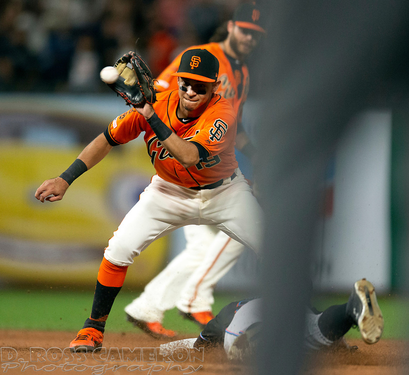 Sep 13, 2019; San Francisco, CA, USA; San Francisco Giants second baseman Mauricio Dubon (19) takes the relay in time to catch Miami Marlins Magneuris Sierra (34) attempting to steal second base during the seventh inning of a baseball game at Oracle Park. Mandatory Credit: D. Ross Cameron-USA TODAY Sports