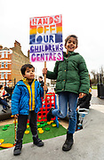 Two children hold a placard as they stage a protest against the closure of Childrens Centres on January 26, 2019 in Brixtons Windrush Square in Lambeth, London, UK. Lambeth Council have announced plans to close five childrens centres in the London Borough of Lambeth and cut services at a number of others. Cuts in childrens centres and services are being proposed by a number of councils across London and the UK.