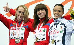 Oksana Zbrozhek, Mariya Savinova of Russia and Elisa Cusma Piccione of Italy at medal ceremony after 800m women run at the 3rd day of  European Athletics Indoor Championships Torino 2009 (6th - 8th March), at Oval Lingotto Stadium,  Torino, Italy, on March 8, 2009. (Photo by Vid Ponikvar / Sportida)