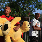 A teenage boy with his winning cuddly toy during the May Fair at Saint Mark's Church, New Canaan, Connecticut, USA. 12th May 2012. Photo Tim Clayton