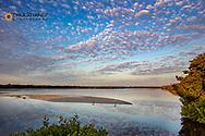 Sunrise clouds over ponds at Ding Darling National Wildlife Refuge in Sanibel Island, Florida, USA