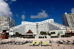 10 Feb 2014. Cancun, Mexico.<br /> The ME Cancun resort hotel overlooking the tourist beach at Isla Cancun along the Zona Hotelera on the Carribean Sea. <br /> Photo; Charlie Varley/varleypix.com