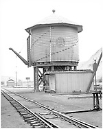"""D&RGW Durango water tank and tool shed - looking south.<br /> D&RGW  Durango, CO  Taken by Rogers, Donald E. A. - 5/26/1939<br /> In book """"Durango: Always a Railroad Town (1st ed.)"""" page 57"""