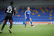 AFC Wimbledon midfielder Jaakko Oksanen (16) dribbling during the EFL Sky Bet League 1 match between AFC Wimbledon and Lincoln City at Plough Lane, London, United Kingdom on 2 January 2021.
