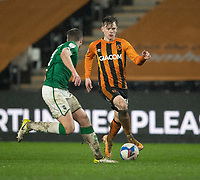 Hull City's Keane Lewis-Potter vies for possession with Lincoln City's James Jones<br /> <br /> Photographer Andrew Vaughan/CameraSport<br /> <br /> EFL Trophy Quarter Final - Hull City v Lincoln City - Tuesday 2nd February 2021 - KCOM Stadium - Kingston upon Hull<br />  <br /> World Copyright © 2021 CameraSport. All rights reserved. 43 Linden Ave. Countesthorpe. Leicester. England. LE8 5PG - Tel: +44 (0) 116 277 4147 - admin@camerasport.com - www.camerasport.com