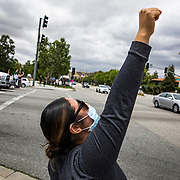 Protesters in Simi Valley, CA demonstrate against police and in support of Black Lives Matter. Simi Valley is a predominantly white, conservative suburb of Los Angeles known for the location of the trial where four LAPD officers were acquitted in the beating of motorist Rodney King. The acquittal led to rioting in 1992.