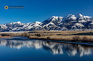 The Yellowstone River in winter with Emigrant Peak and Absaroka Mountains in Paradise Valley, Montana, USA