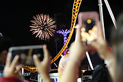 July 4, 2017-Brooklyn, NY-United States:  Brooklynites and Tourists celebrate the United States of America's 241st Birthday on the 4th of July with Fireworks held at Brooklyn's Coney Island on July 4, 2017 in Brooklyn, New York. As the nation struggles to move forward with a myriad of concerns about the 45th President of the United States, the nation celebrates its birth. (Photo by Terrence Jennings/terrencejennings.com)