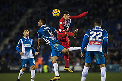 December 22, 2017 - Barcelona, Spain - BARCELONA, SPAIN - DECEMBER 22: 21 Kevin Gameiro of France of Atletico de Madrid defended by 06 Oscar Duarte from Nicaragua of RCD Espanyol  during the match of La Liga Santander between RCD Espanyol v Atletico de Madrid, at RCD Stadium in Barcelona on 22 of December, 2017. (Credit Image: © Xavier Bonilla/NurPhoto via ZUMA Press)