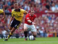 Wayne Rooney Manchester United/Olof Mellberg Aston Villa<br />The Premier League<br />Manchester United V Aston Villa 20/08/05<br />Photo Robin Parker Fotosports International