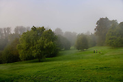 A misty springtime with dog walkers talking in Waterlow Park, 13th Sept 2006, Highgate, North London United Kingdom. Waterlow Park is a 26-acre  park given to the public by Sir Sydney Waterlow, as a garden for the gardenless in 1889.