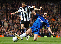 Photo: Ed Godden.<br /> Chelsea v Newcastle United. The FA Cup. 22/03/2006.<br /> Kieron Dyer (L) is tackled by Chelsea's Frank Lamard.