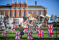 © Licensed to London News Pictures. 31/08/2017. London, UK. Tributes left at the gates to Kensington Palace in London on the 20th anniversary of the death of Diana, Princess of Wales. Princess Diana was fatally injured in a car crash along with her companion Dodi Fayed, while the couple were being driven through the Pont de l'Alma tunnel in Paris on 31 August 1997. Photo credit: Ben Cawthra/LNP